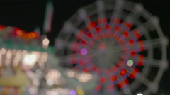 Spinning Ferris Wheel Carnival Out of Focus Colorful Lighting Stock Footage