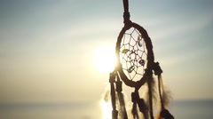 Dream Catcher Swinging at the Sea Sunset. Slow Motion Stock Footage