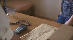 Man completing mobile Payment using modern smart Phone Technology at Store Stock Footage