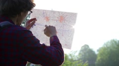 Male hiker using compass and map in forest Stock Footage