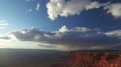 From Sky To High Desert Plateau Towards Vast Canyon Vista at Sunset Stock Footage