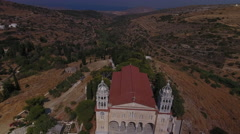 Aerial reveal of Greek church and village in mountains. Stock Footage
