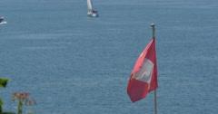 4K, Flag at  Brienzersee, Switzerland Stock Footage
