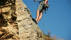 Rock climber showing finger Stock Footage