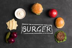 Hamburger with meat cutlet. Inscription of ingredients Stock Photos