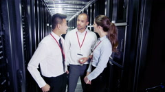Portrait of three attractive smiling IT engineers Stock Footage