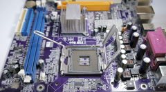 Assembling a computer motherboard Stock Footage