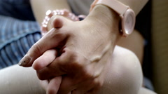 Close-up of hands of mother and daughter holding each other at home Stock Footage