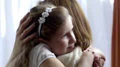 Emotional little girl hugging her loving mother at home Stock Footage