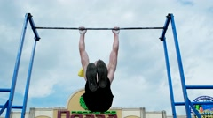 Tumble on the bar, pull-ups, strength training outdoors Stock Footage