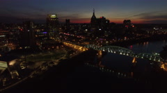 Flying Over River Bridge And Downtown Nashville at Dusk Stock Footage