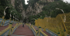 In Batu Caves seen long stairs and mountain with greenery Stock Footage