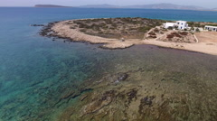 Rocky, quiet coastline with clear blue water on Greek island, aerial. Stock Footage