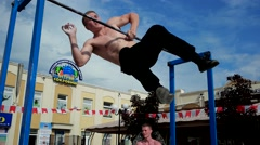 Acrobat athlete trains on the transverse bar Stock Footage