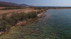 Coastline with stone beaches and clear blue water, aerial. Stock Footage