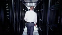 Two men of mixed ethnicity are working in a data centre Stock Footage