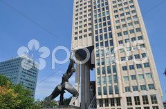 Statue support a building Stock Photos