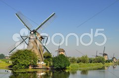 Dutch mills over a river Stock Photos