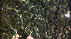 Foodsteps over Stones in Cold Water - Kneipp Water Cure path Stock Footage