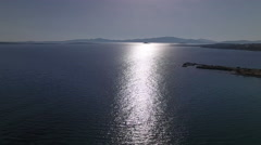Sun reflecting over sea, aerial shot Stock Footage