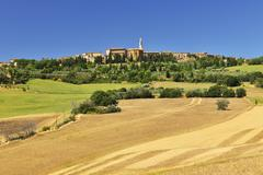 Wheat Field in Summer with a Historic Town of Pienza, Province of Siena, Stock Photos