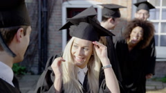 Happy multi-ethnic group of friends together on graduation day Stock Footage