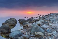 Stony Beach at Sunset, Fyns Hoved, Hindsholm, Kerteminde Municipality, Funen, Stock Photos