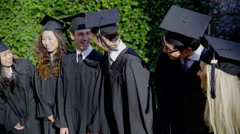 A happy and excited multi-ethnic group of friends on graduation day Stock Footage