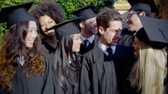 Happy multi-ethnic group of friends together on graduation day Shot on RED Epic Stock Footage