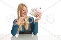 Mädchen, Blondine mit Geldbündel Stock Photos