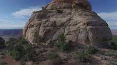 Rising From Desert High Over Strange Rock Formation at Epic Canyon Vista Stock Footage