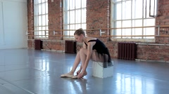 Young female ballet dancer exercising in ballet class Stock Footage