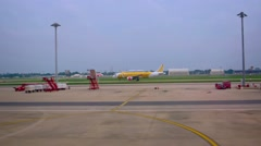 Airliner taxiing past passenger terminal at Don Mueang International Airport Stock Footage
