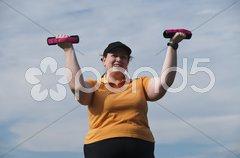 XXL-Model, übergewichtige Frau macht Sport im Freien Stock Photos