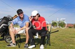 Zwei junge Golfer, frustriert Stock Photos