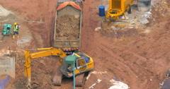 Timelapse of excavator loading truck Stock Footage