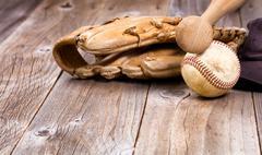 Used baseball equipment on rustic wooden boards Kuvituskuvat