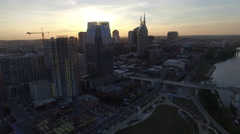 Soaring Past Nashville Skyscraper As Setting Sun Flares Stock Footage