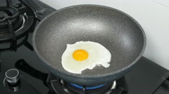 Cooking eggs on a gas stove Stock Footage
