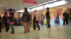 Passengers waiting in line at the boarding gate, inside Hong Kong Airport Stock Footage