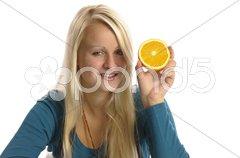 Mädchen mit Orange Stock Photos