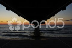 Pier going out into the Baltic Sea at dusk with copyspace Stock Photos