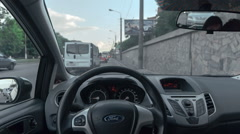 POV standing in a car on roadside, traffic passing by Stock Footage