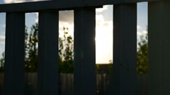 Fence silhouette sunlight video glare the movement Stock Footage