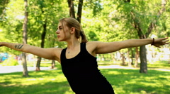 Mid shot Young woman doing yoga in park Stock Footage