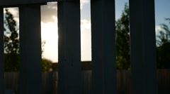 Fence silhouette sunlight glare the movement video Stock Footage