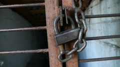 Old iron lock on the iron video bars prison Stock Footage