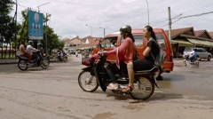 Chaotic traffic at the intersection in slow motion. Cambodia Stock Footage