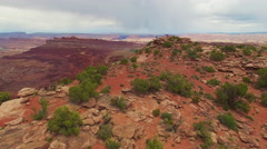 Flying Over Desert and Photographer at Edge of Cliff and Epic Vista Stock Footage
