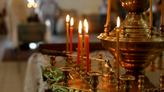 Candles are lit in the Russian Orthodox Church Stock Footage